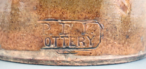 Detailed shot of most common PEI Pottery Company maker's stamp.