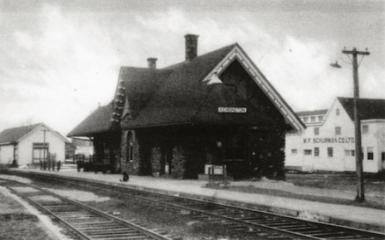 Old black and white photo showing outside of Kensington Station