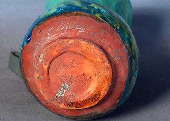 "(Figure 5 - HF.12.08.07) View of a Doull vase base, signed ""M.D. PEI"" with ""Aunt Mary Doull"" written in pencil."